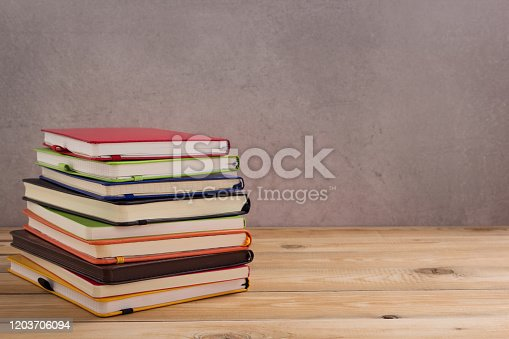 istock notepad or paper notebook at wooden table 1203706094