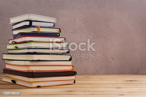 istock notepad or paper notebook at wooden table 1203706107