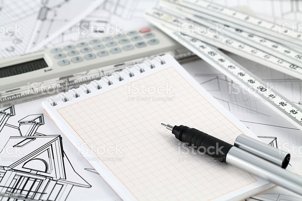 notepad, pen and architectural drawings royalty-free stock photo