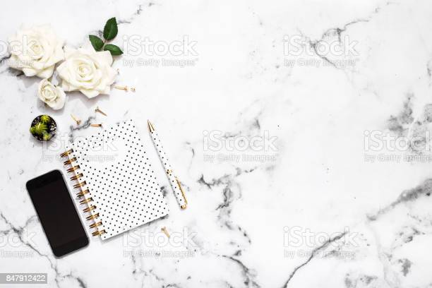 Notepad pen mobile phone and office supplies on marble table top picture id847912422?b=1&k=6&m=847912422&s=612x612&h=bnnma0dsuy6tk s7k 9c9hzxlmrb4podd czvdt8i18=
