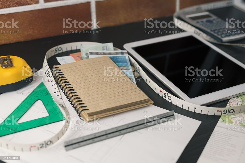 Notepad, tablet and office tools for construction budget calculation stock photo