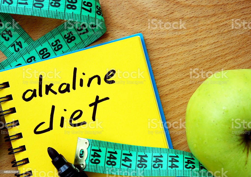 Notepad with alkaline diet. stock photo