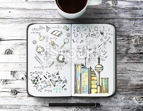 istock Notepad with creative sketch 679954842