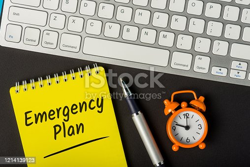 694587746 istock photo Notepad with Emergency or disaster plan on a workplace 1214139123