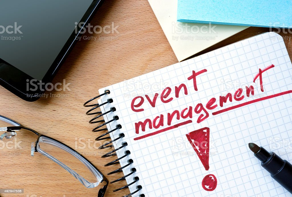 Notepad with event management  on office wooden table. stock photo