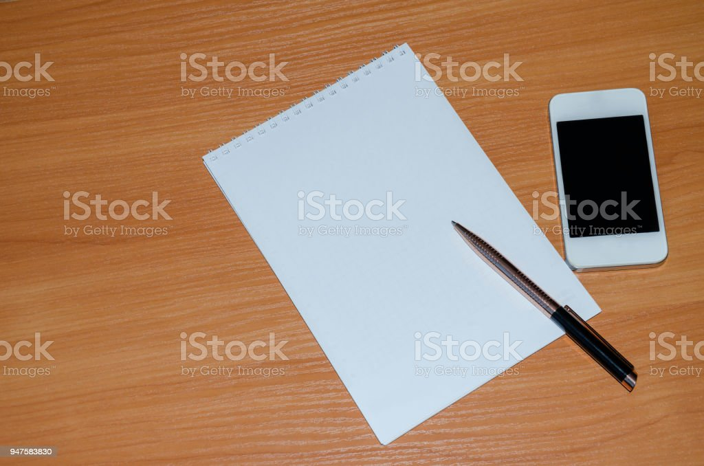 Notepad with pen stock photo