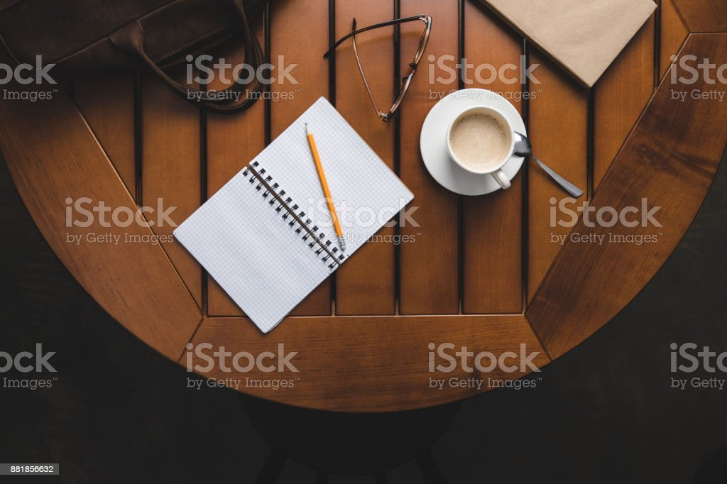 notepad with pencil and coffee stock photo