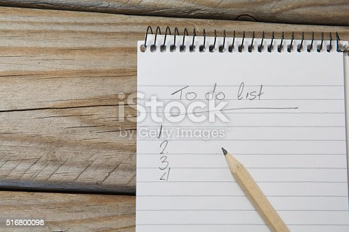 524051315 istock photo notepad with pencil on a wooden table 516800098