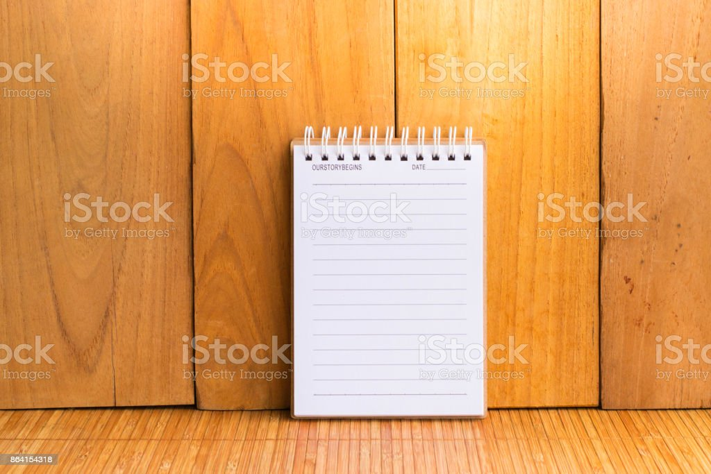 Notepad with pencil on wood board background.using wallpaper for education, business photo.Take note of the product for book with paper and concept, object or copy space. royalty-free stock photo