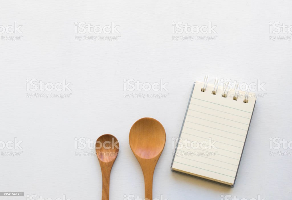 Notepad with spoons and vegetable on wood wood background.Using wallpaper for food, kitchen and cook composition image Take note product for book with paper and concept or copy space with note royalty-free stock photo