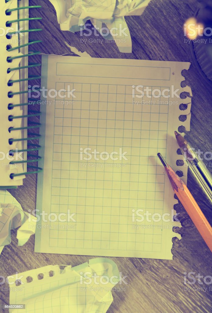 Notepad with writing utensils stock photo