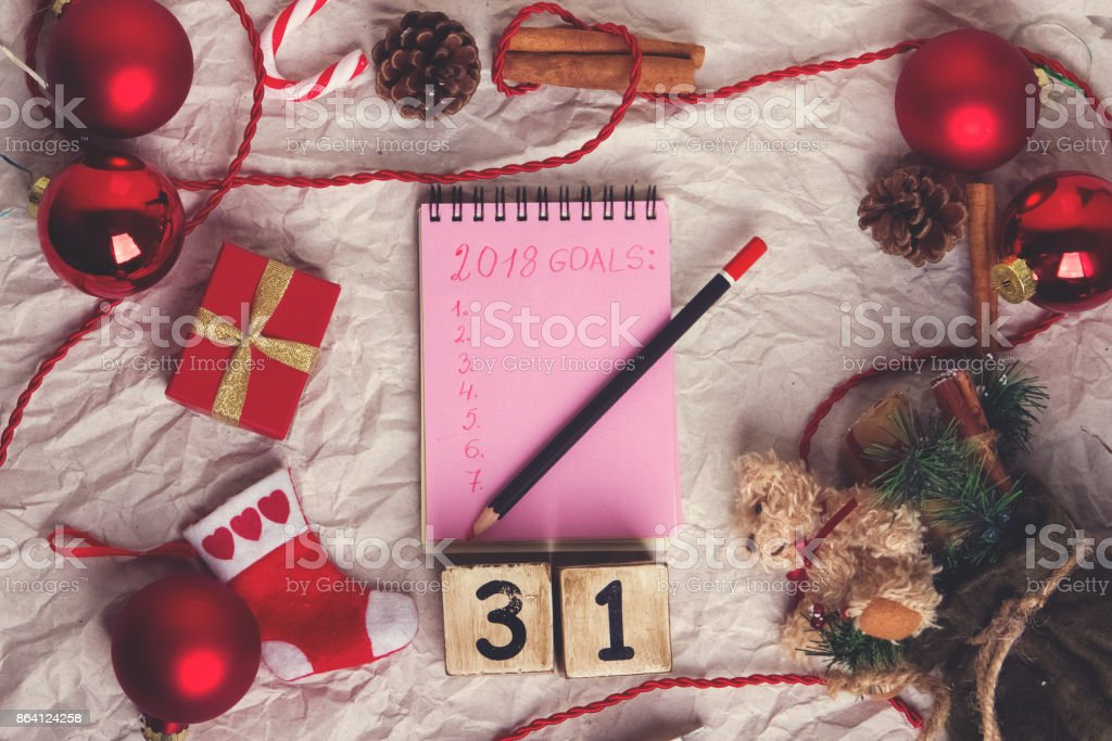 Notepad with xmas Decoration. Goals for new Year royalty-free stock photo