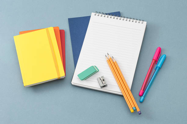 Notepads, eraser and colorful pencils. stock photo