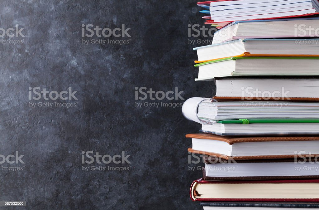 Notepads in front of chalk board stock photo