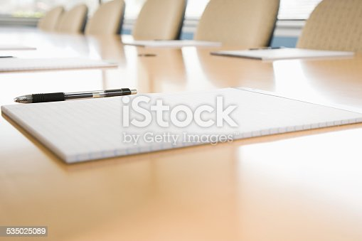 Notepads on conference table