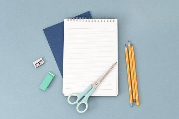 Notepads, scrissor and yellow pencils, stock photo