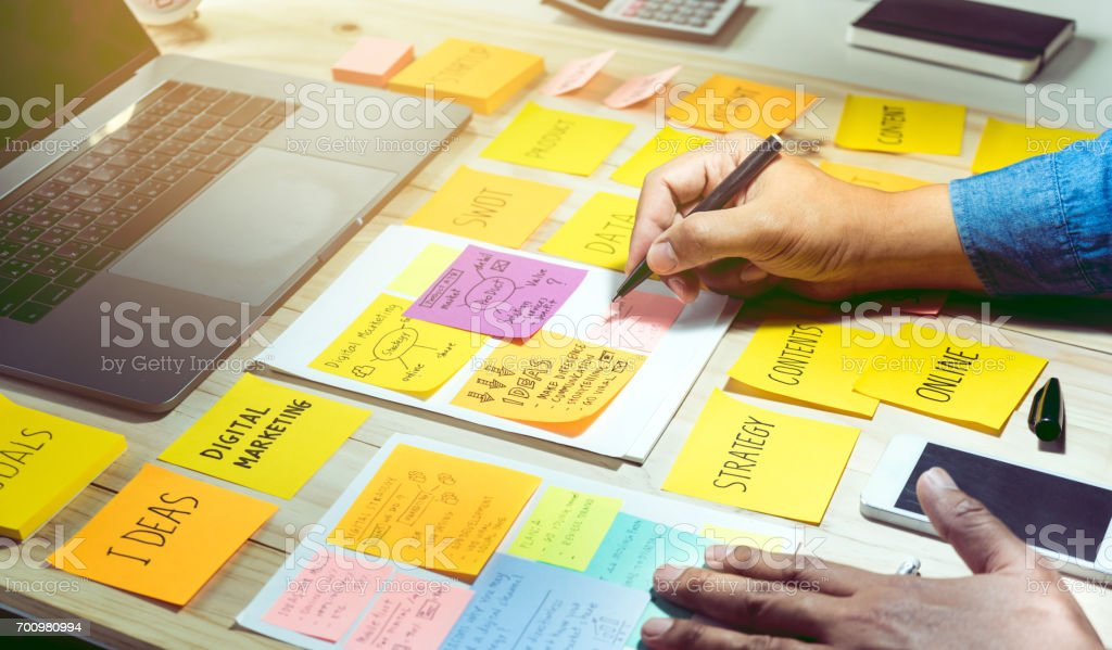 Notepaper with male hand.Business brainstorming and communication marketing plan concept