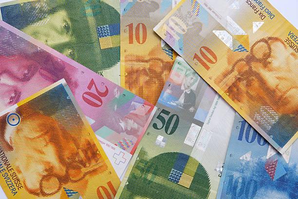 notes of swiss francs currency - franken stockfoto's en -beelden