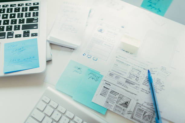 Notes on a desk of a designer stock photo