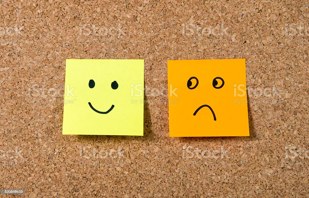notes on corkboard in happiness versus depression concept stock photo
