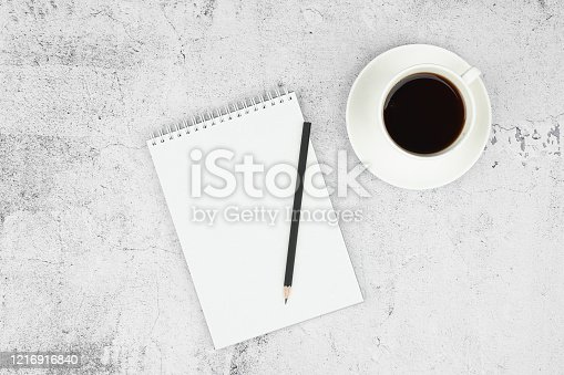 istock Notes on paper. Phone and notebook layout with pen and coffee on a flat lay. View from above. Place for writing 1216916840