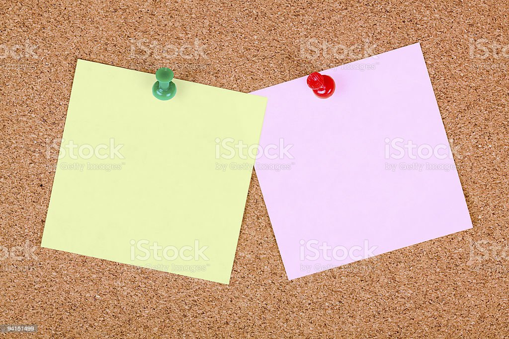 Notes pinned to cork board. royalty-free stock photo