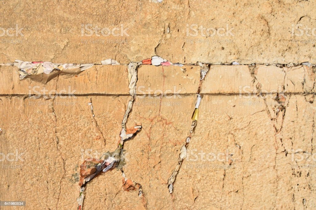 Notes to God between the bricks of the Western Wall stock photo
