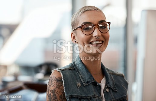 Portrait of an attractive and confident creative young businesswoman smiling inside her office