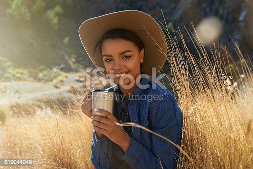 Cropped shot of a young woman spending time in a wheat field