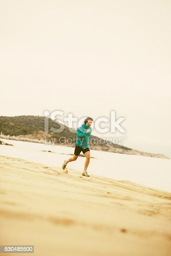 Young man relaxation jogging training at seaside on sandy beach. Image taken with Nikon D800 and professional Nikon lens, developed from RAW in XXXL size. Location: Sithonia, Greece, South Europe, Europe