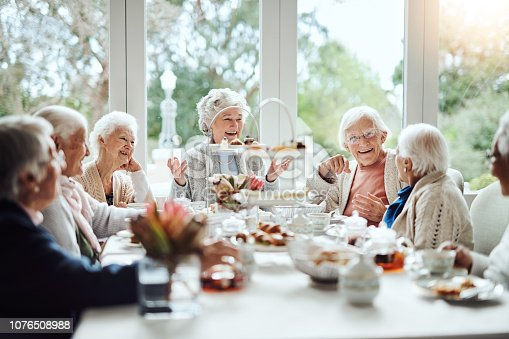 1053414472istockphoto Nothing brings friends together like a good old tea party 1076508988
