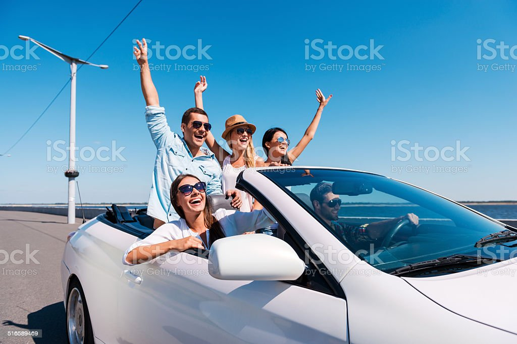 Nothing but friends and road ahead. stock photo