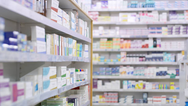 Nothing but the best brands for their customers Shot of shelves stocked with various medicinal products in a pharmacy pharmacy stock pictures, royalty-free photos & images