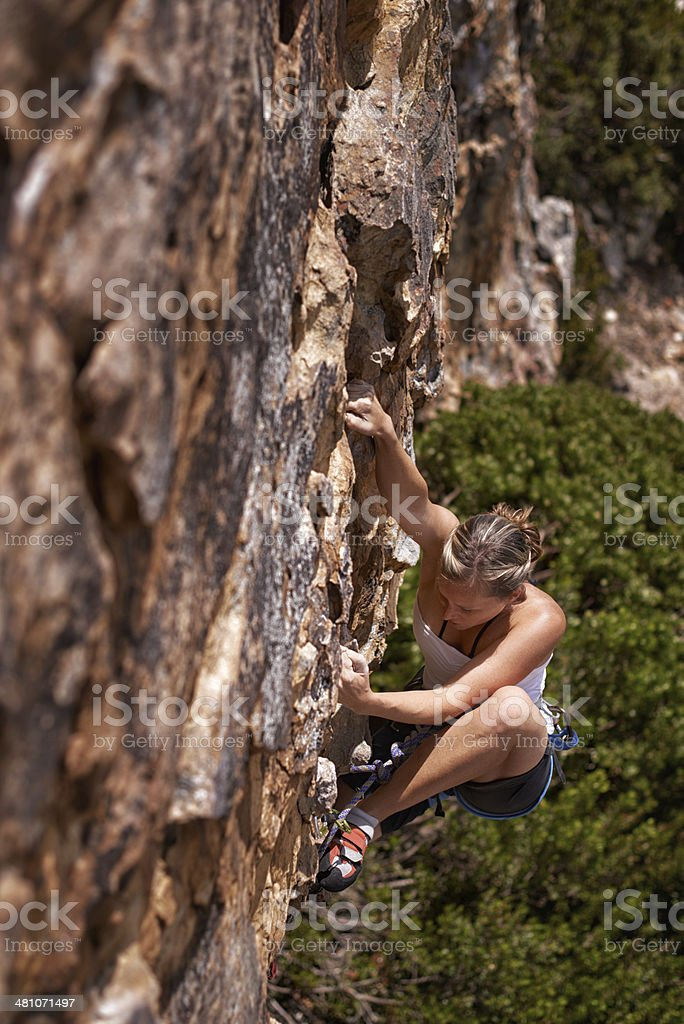 Nothing gets the heart going like scaling a mountain stock photo