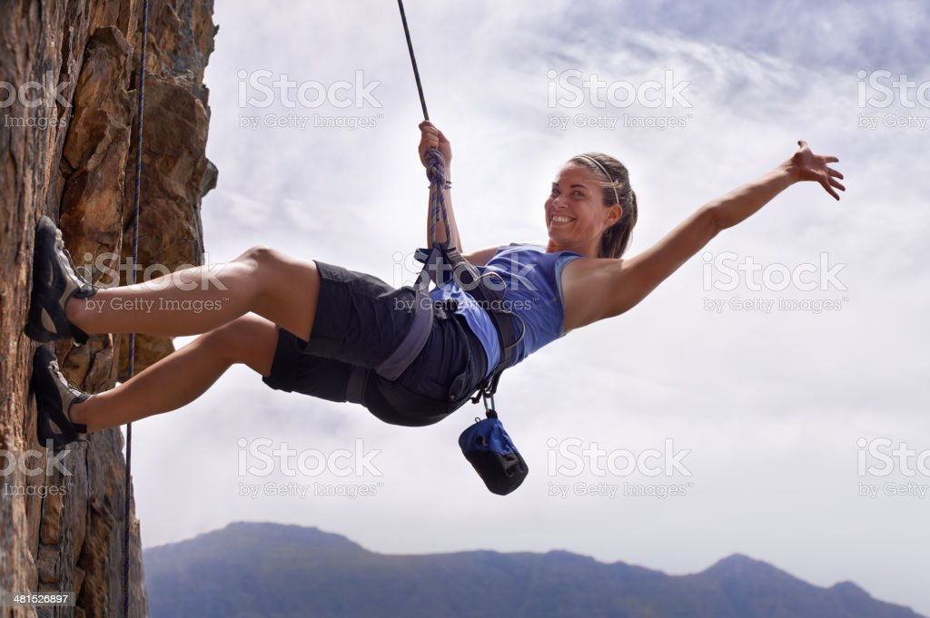 Nothing gets the heart going like scaling a rock face stock photo