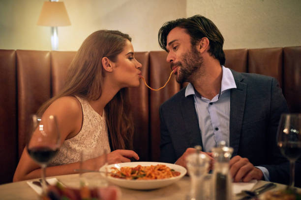 nothing inspires romance quite like italian food - italian food stock photos and pictures