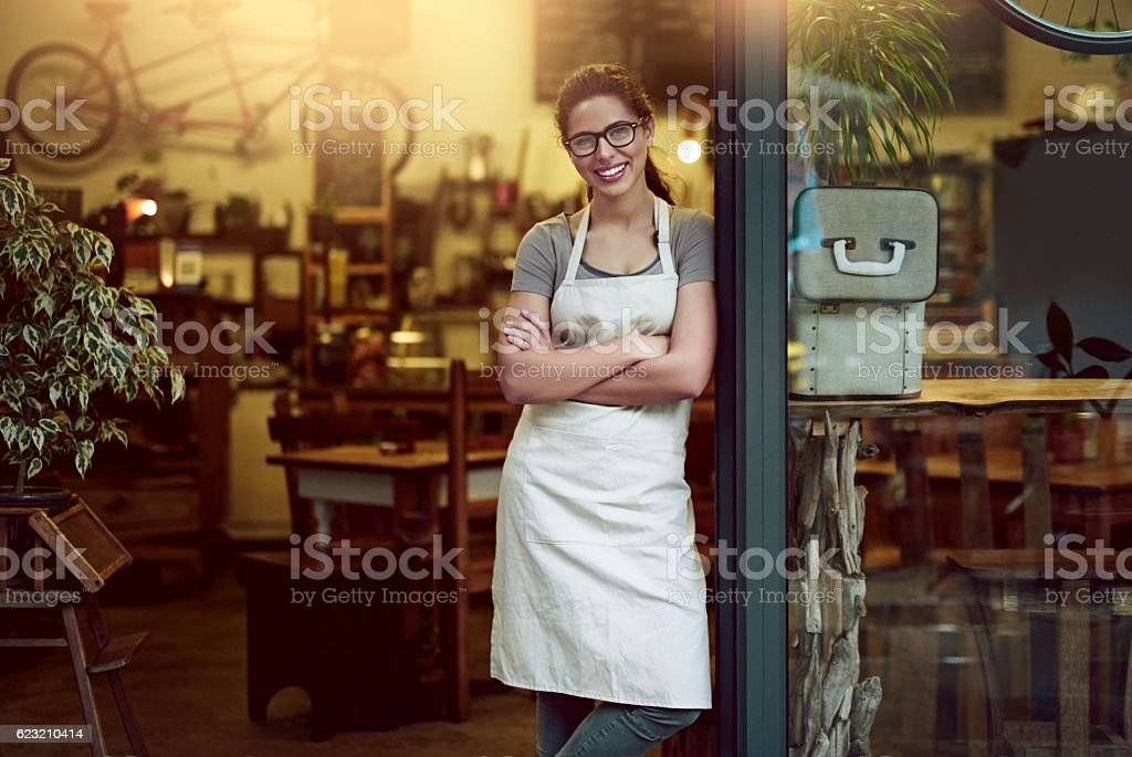 Nothing invites customers to your store like a welcoming smile stock photo