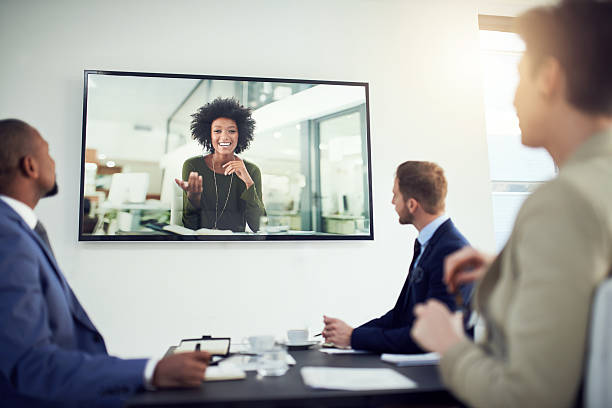 nothing is lost in translation thanks to video calling - projection screen stock photos and pictures