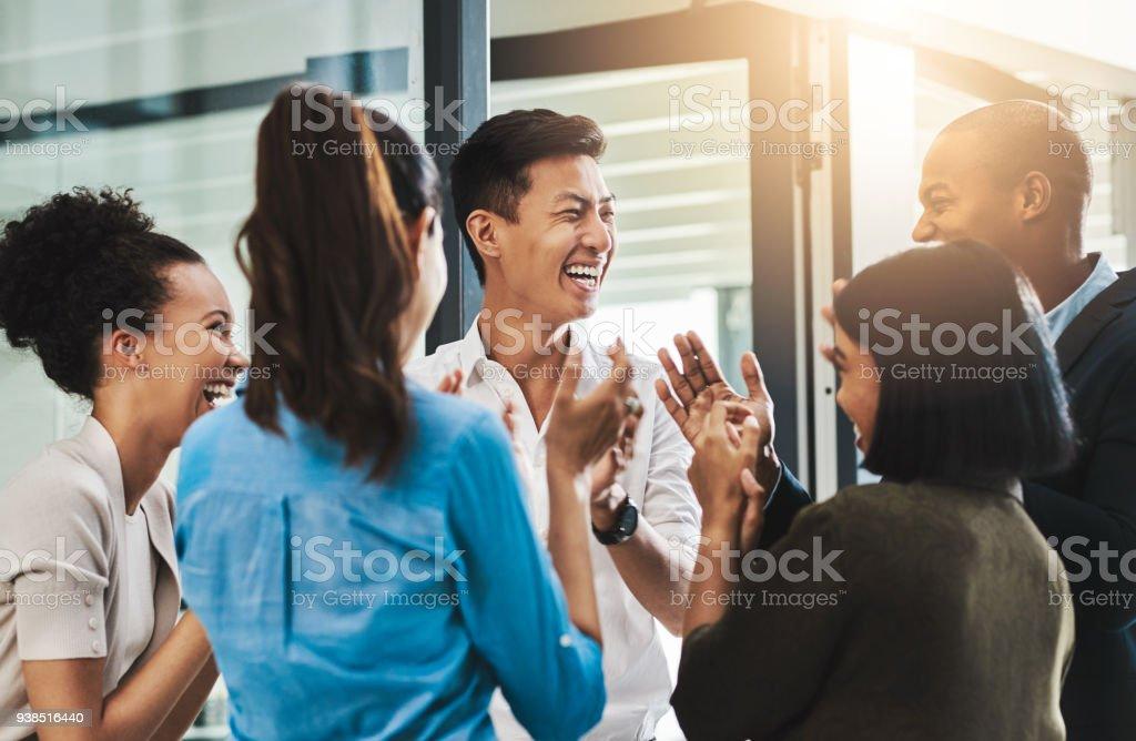 Nothing motivates productivity like team morale stock photo