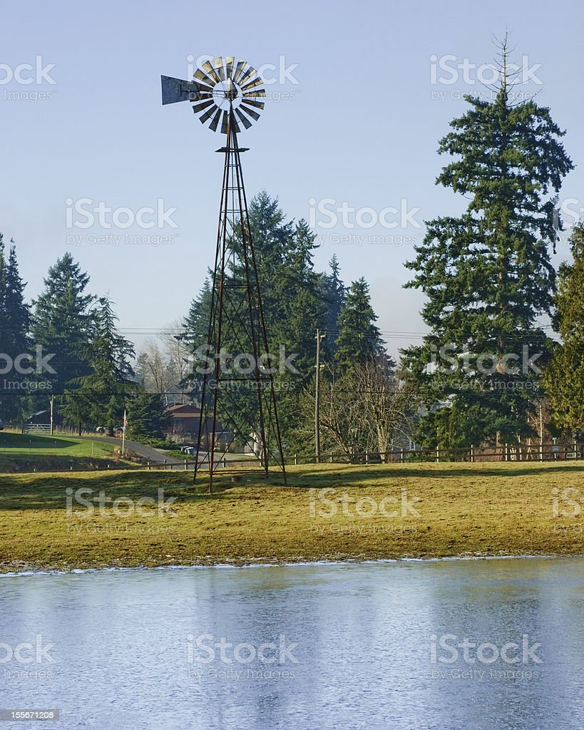 Old Windmill by a Pond royalty-free stock photo