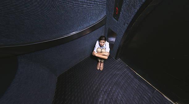 nothing to do but wait - claustrofobie stockfoto's en -beelden