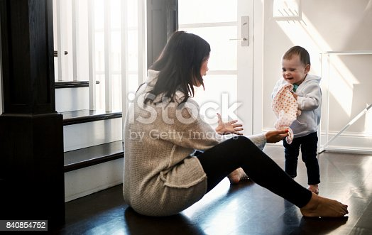 Shot of an adorable baby girl walking into her mother's open arms at home