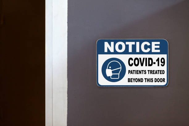 Notice - COVID-19 patients treated beyond this door stock photo