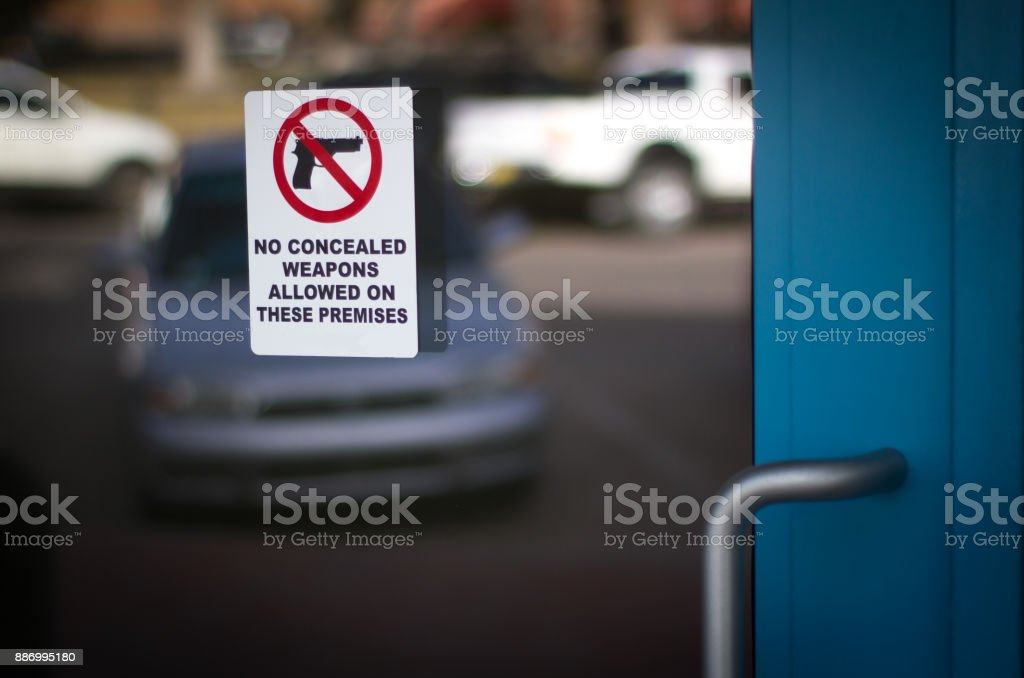 Notice for Gun-Free Zone/No Concealed Weapons Sign stock photo