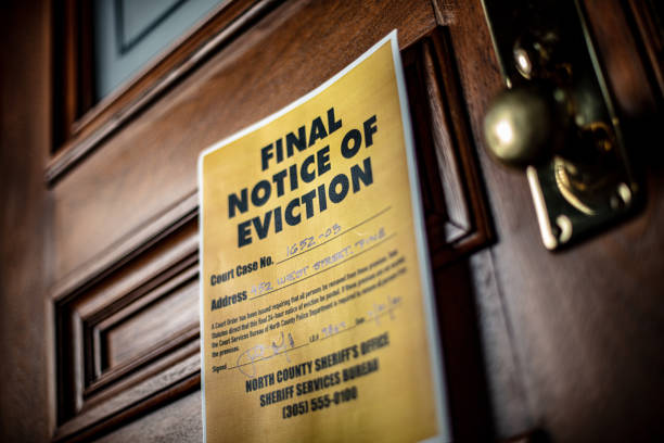 Notice of Eviction docuement on door of house stock photo