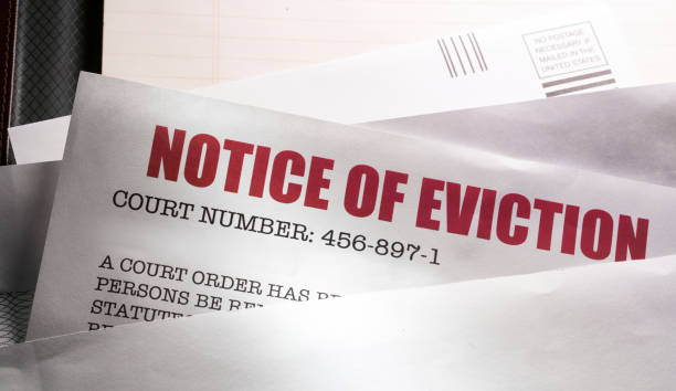 Notice of Eviction mail with protective mask stock photo