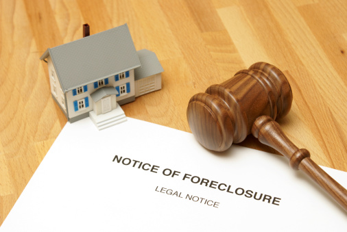 182148217 istock photo Notice of foreclosure document with model house and gavel 183564684