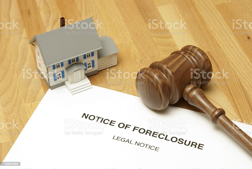 Notice of foreclosure document with model house and gavel stock photo