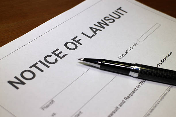 Notice of Lawsuit Someone filling out Notice of Lawsuit Form. lawsuit stock pictures, royalty-free photos & images