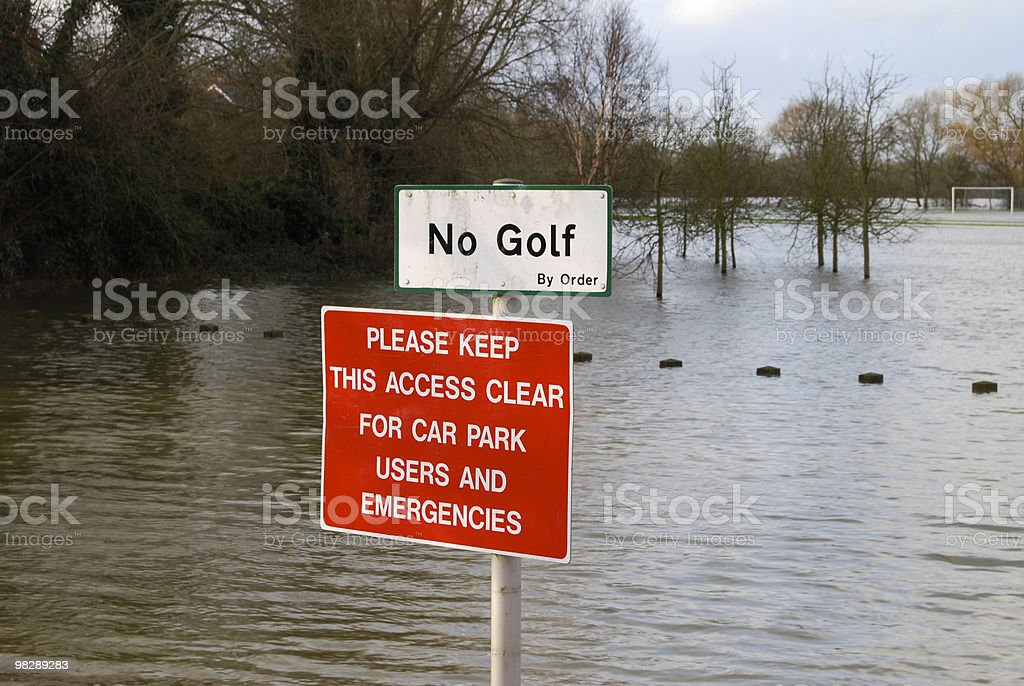 Notices by flooded field. Oxford. England royalty-free stock photo